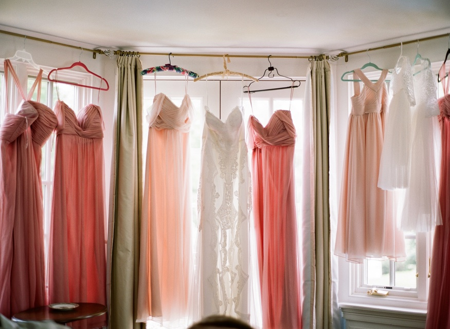 Bride's dress by Jane Hill. Bridesmaids' dresses by Amsale at New Jersey backyard wedding.