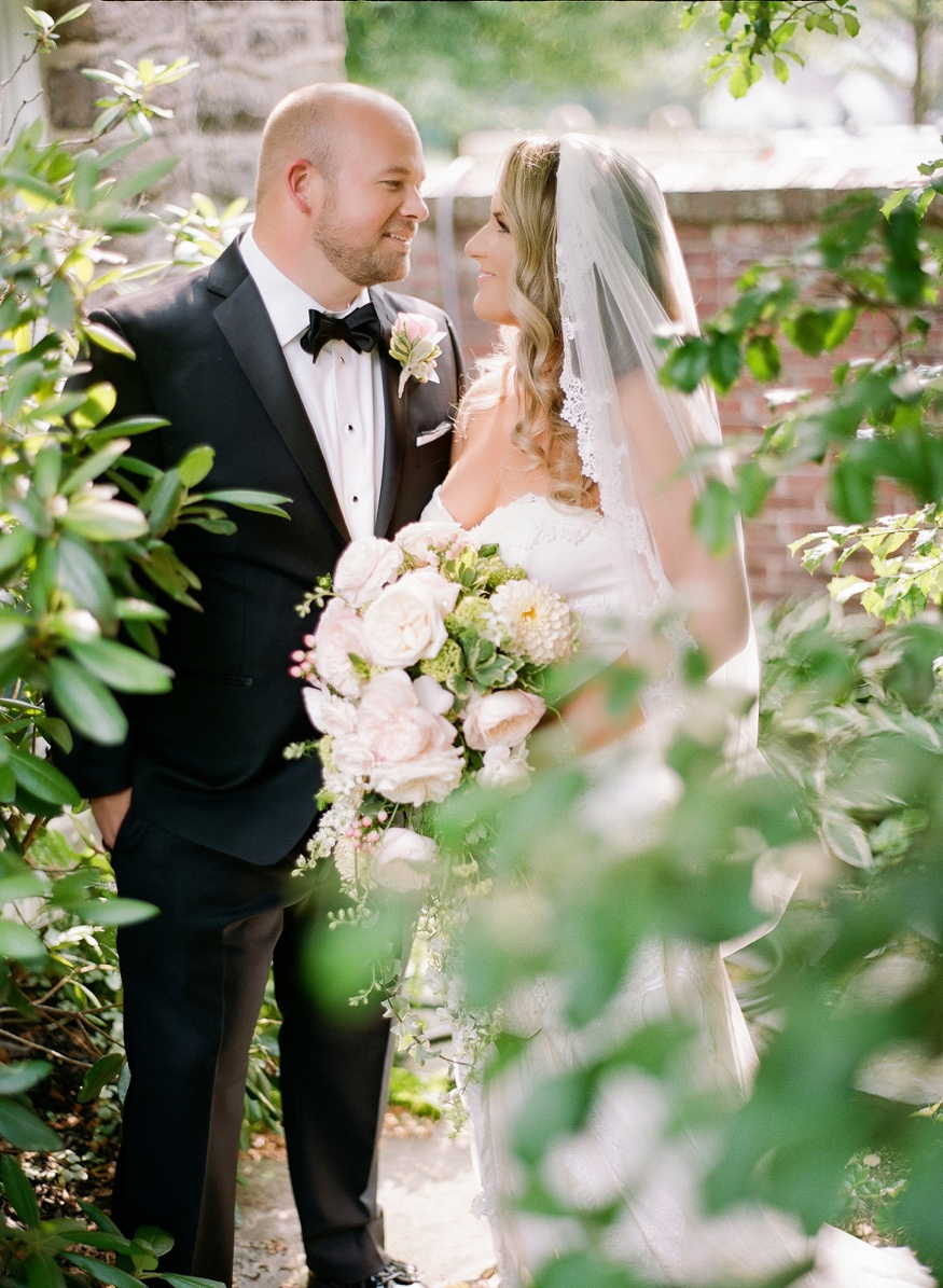 Bride and Groom portraits in garden at New Jersey backyard wedding.