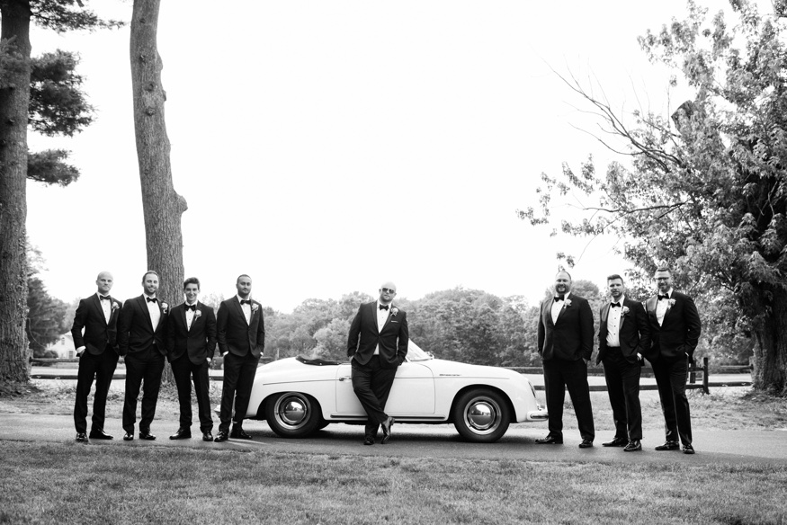 Groomsmen portraits with vintage car at New Jersey backyard wedding.