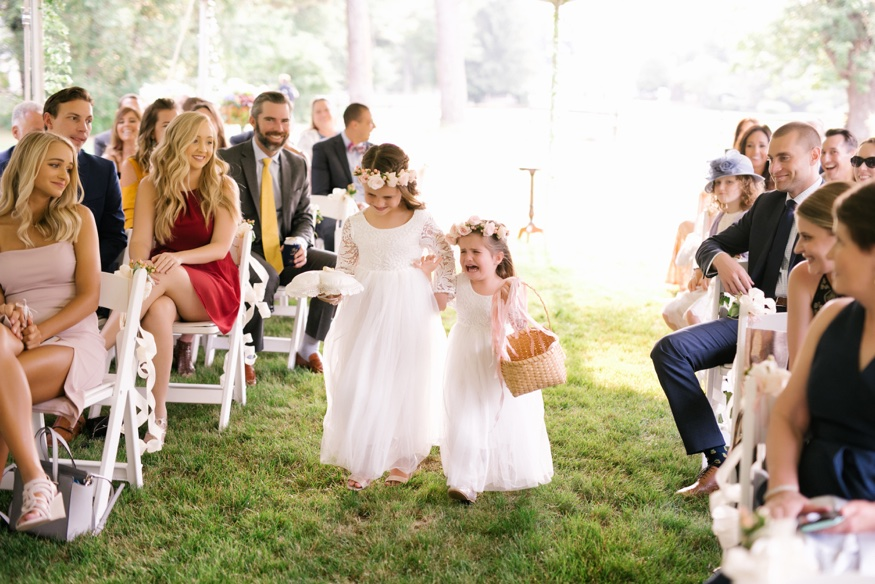 Tented ceremony at New Jersey backyard wedding.