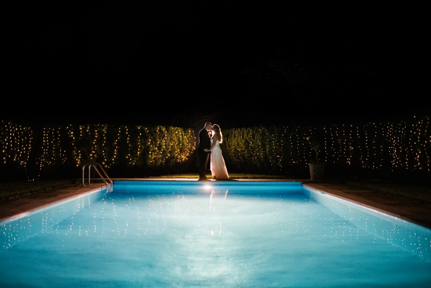 Night portraits with fireworks at New Jersey backyard wedding.