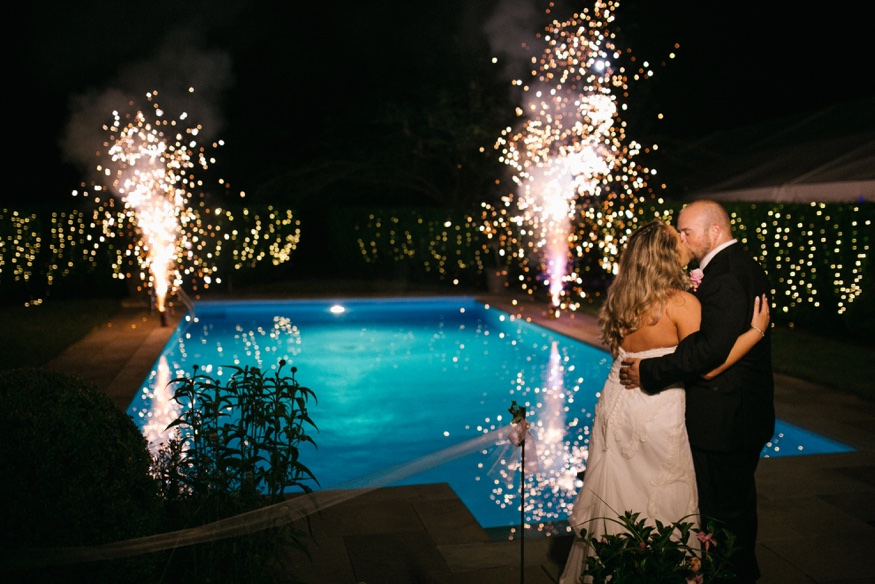 Night portraits with fireworks at New Jersey backyard wedding.