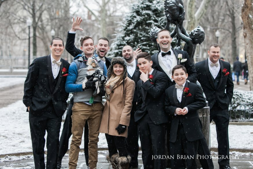 Groomsmen photobombed with strangers in Rittenhouse Square befor their Fairmount Park Horticulture Center wedding.