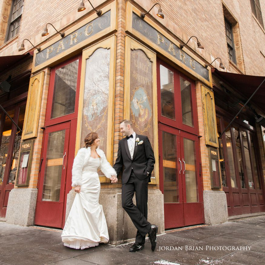 Bride and groom photo in front of Parc restaurant in Rittenhouse Square befor their Fairmount Park Horticulture Center wedding.