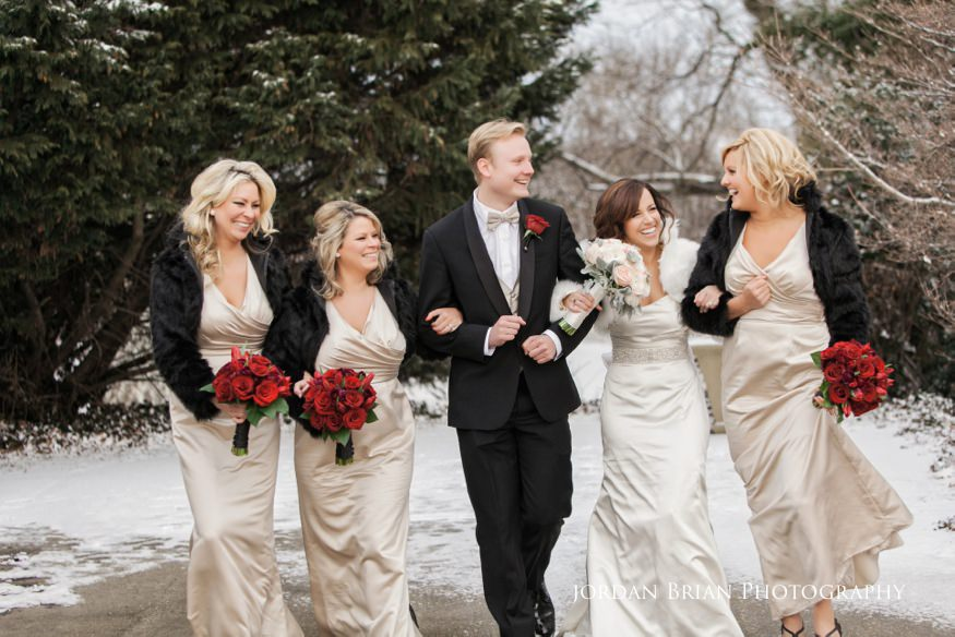 Photo of walking bridesmaids at Fairmount Park Horticulture Center wedding.