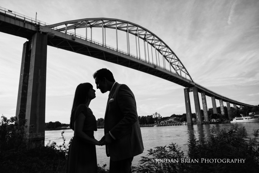 couple infront of chesapeake city bridge engagement session