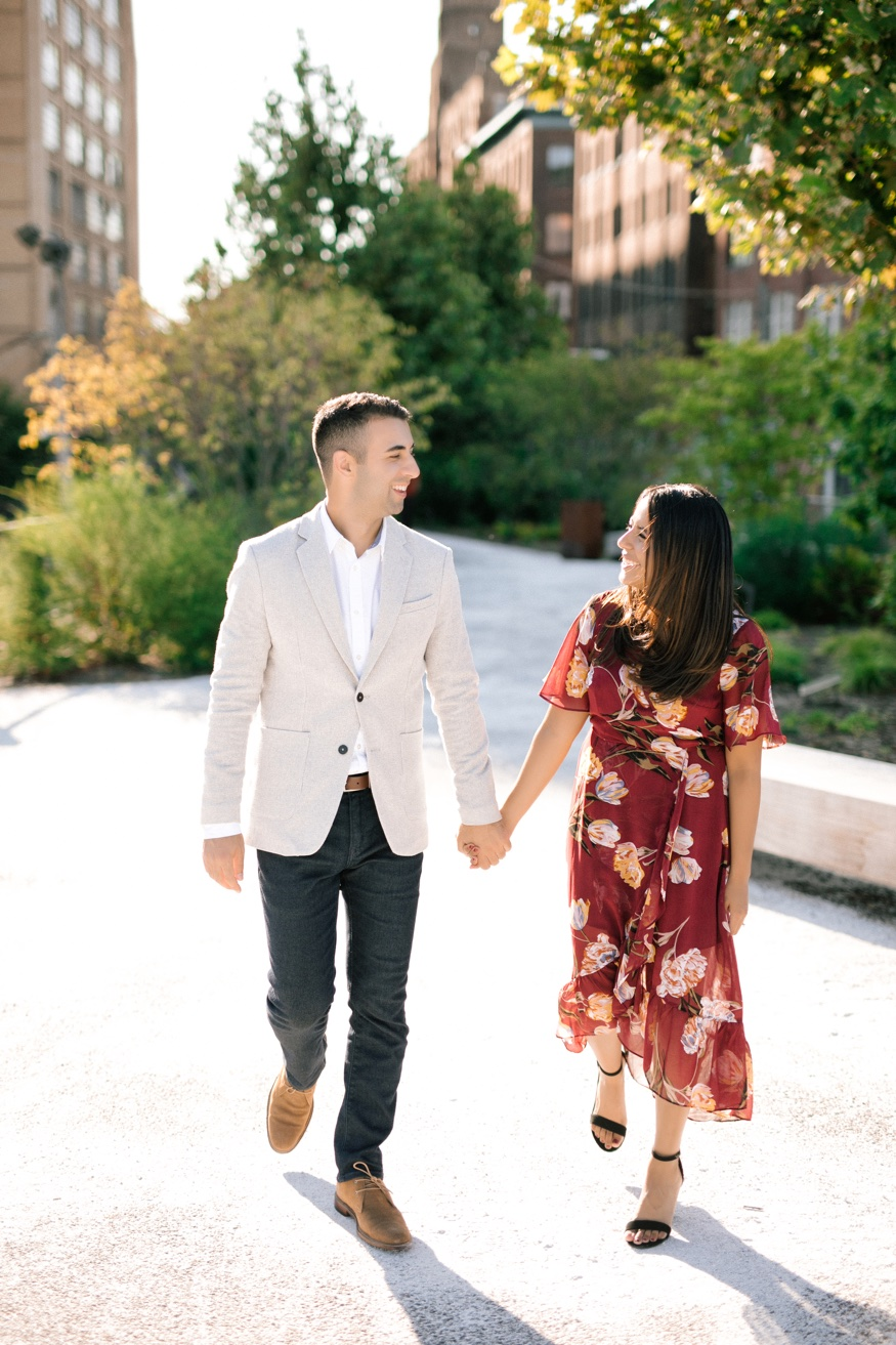 The Rail Park Philadelphia engagement session walking together.