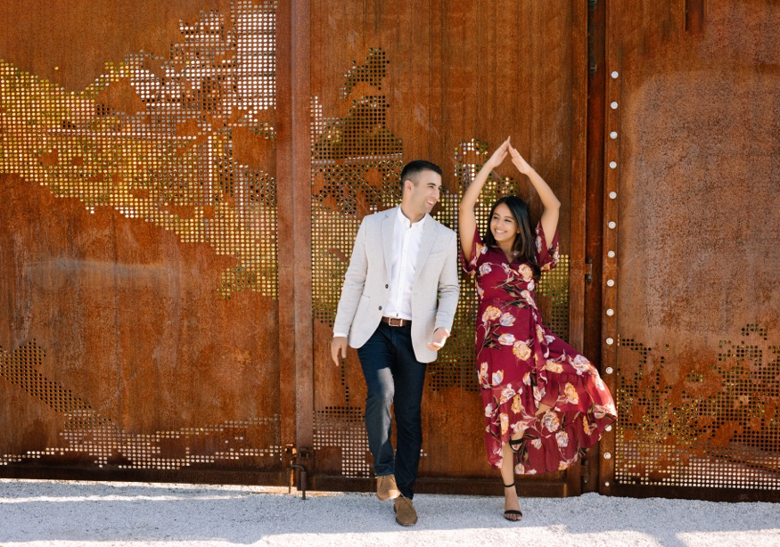 The Rail Park Philadelphia engagement session couple playing by rusted fencing