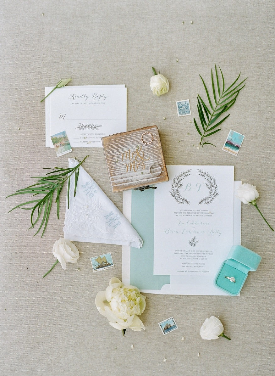 Wedding invitations by Pauline's Papery.