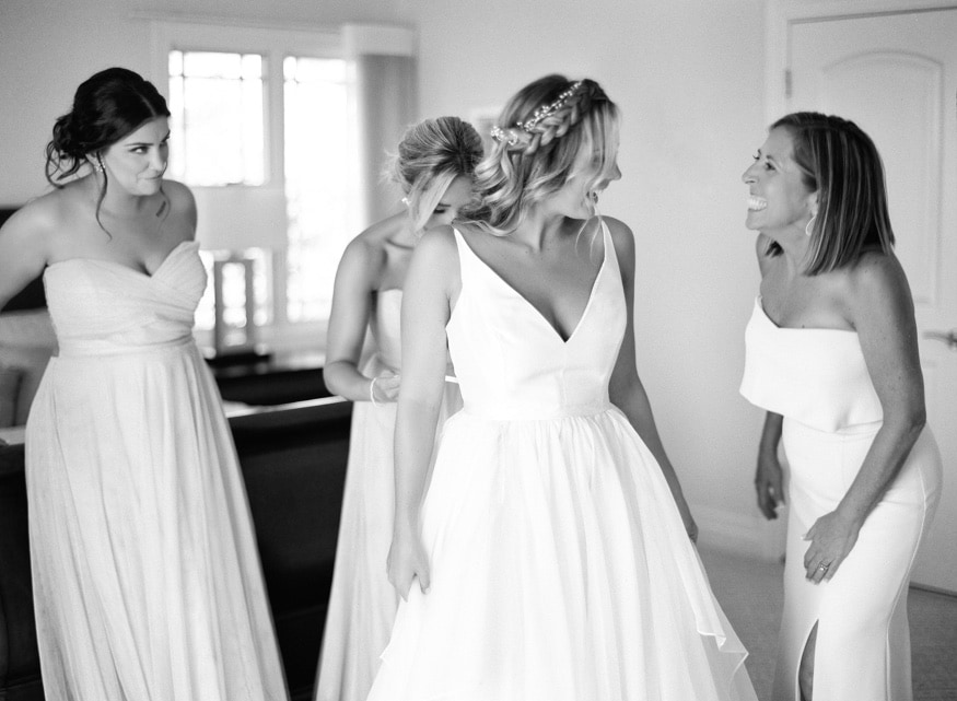 Bride getting ready in her Leanne Marshal wedding dress at Windows on the Water wedding.