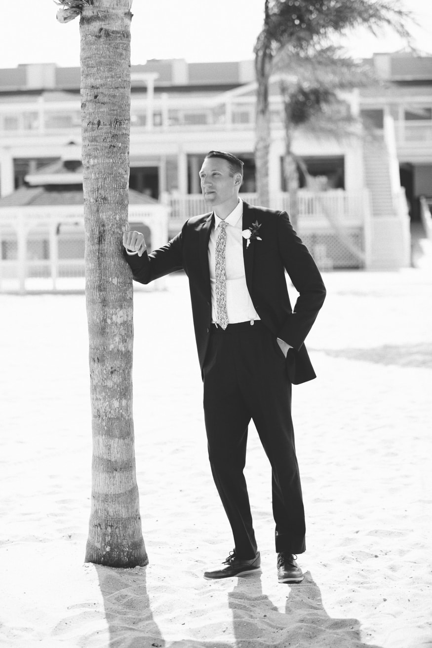 Groom's portraits at Windows on the Water at Surfrider Beach Club.