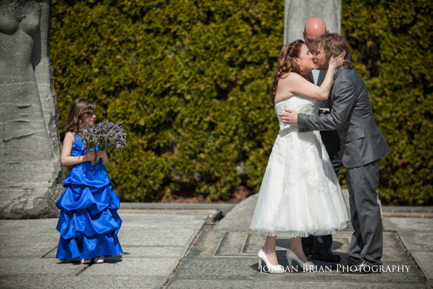 Kiss during marriage ceremony at Grounds for Sculpture in Hamilton, NJ