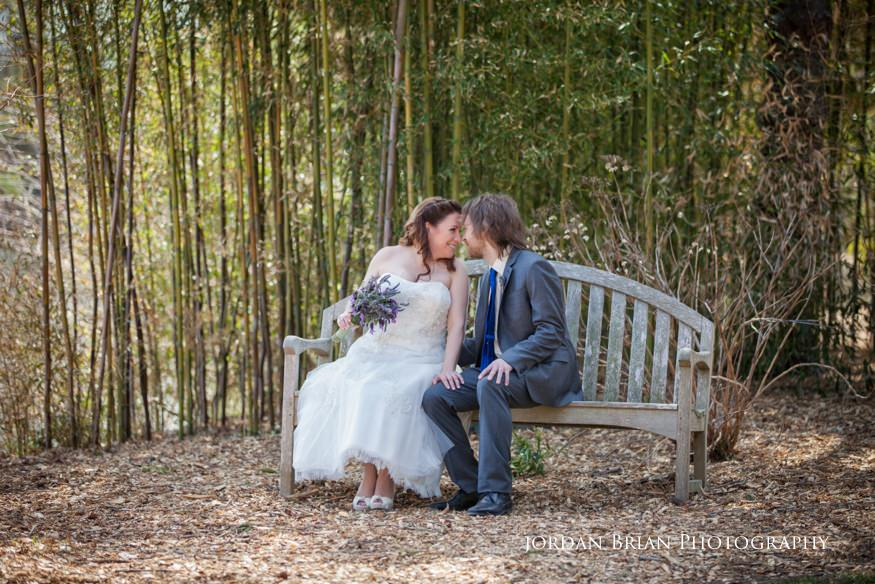 Bride and groom on bench at Grounds for Sculpture wedding