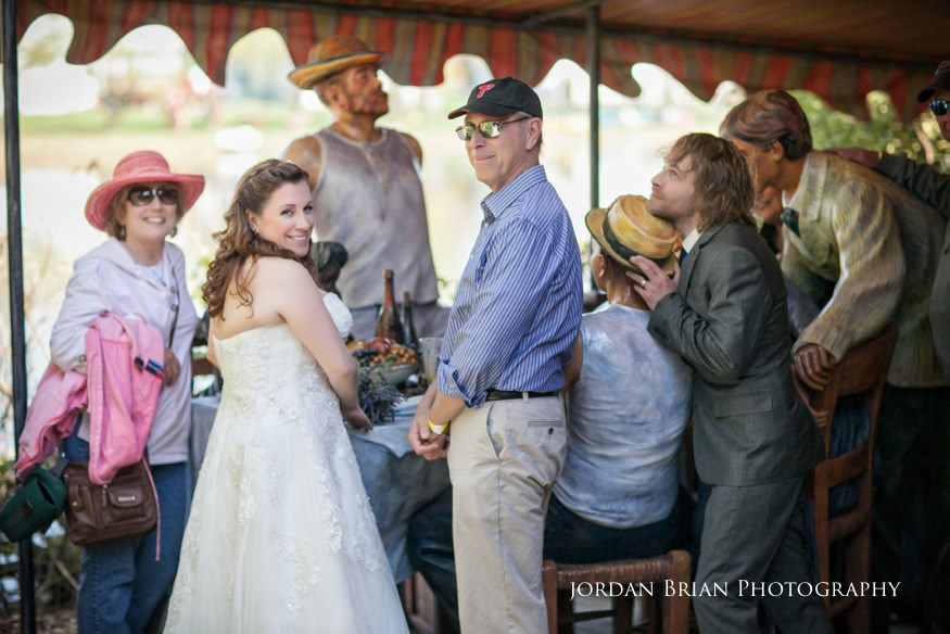 Photobombed bride and groom photos at grounds for sculpture with Seward Johnson exchibit