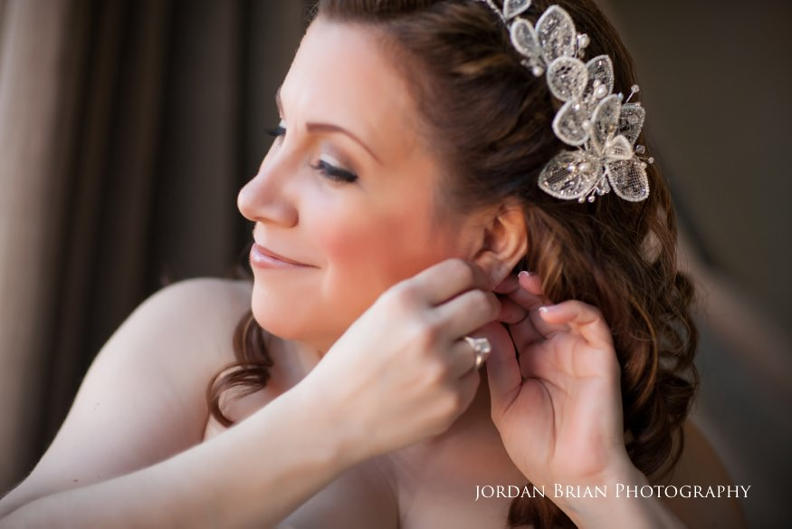 Bride preps earings before Grounds for Sculpture wedding