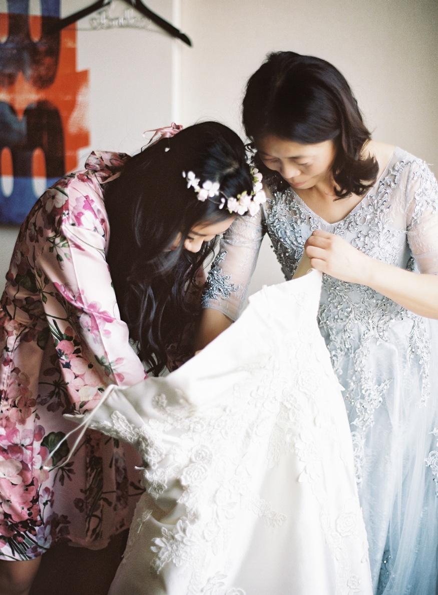 Bride getting ready before Brookyln Botanic Garden wedding. Wedding dress by Liancarlo from Kleinfeld Bridal.