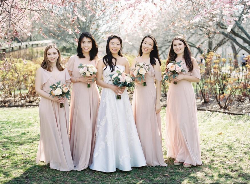 Bridemaids by Cherry Blossoms at Brooklyn Botanic Garden wedding.