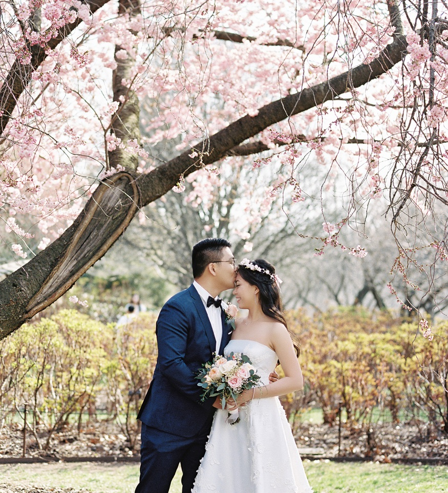 Bride and Groom by Cherry Blossoms at Brooklyn Botanic Garden wedding.