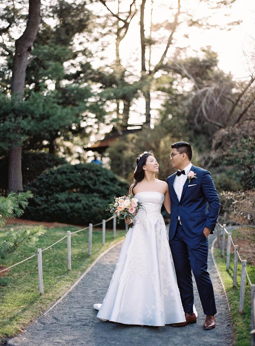 Bride and groom walking through Brooklyn Botanic Gardn wedding.