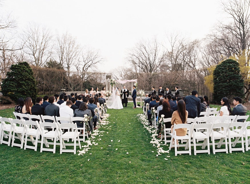 Outdoor wedding cermeony at Spring Brooklyn Botanic Garden wedding.