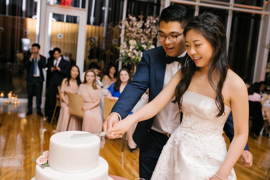 Cake cutting at Brooklyn Botanic Garden wedding reception.