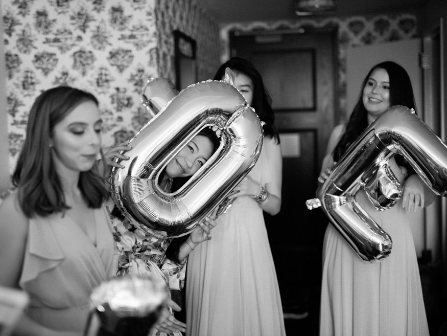 Bridesmaids getting ready with Bride at Hilton Brooklyn Hotel before Brooklyn Botanic Garden wedding.